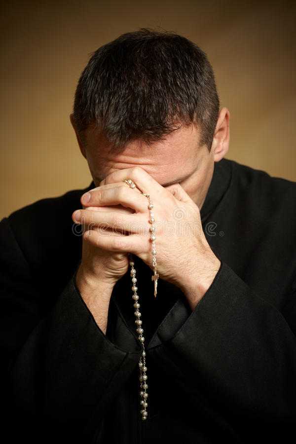 Free Praying Priest Stock Images - 12877754