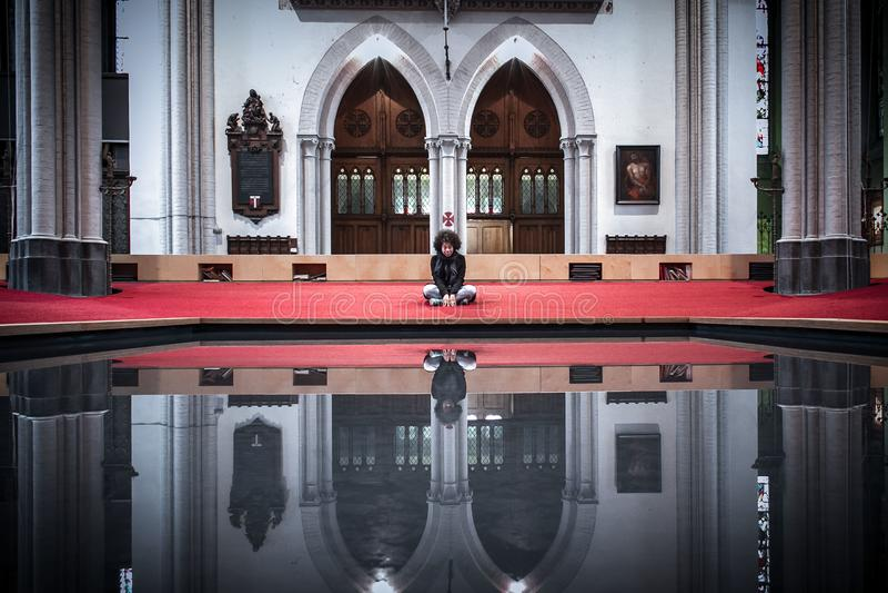 Praying and reflecting stock photo