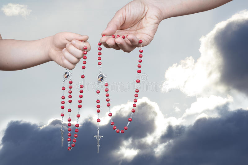 Praying the rosary stock images
