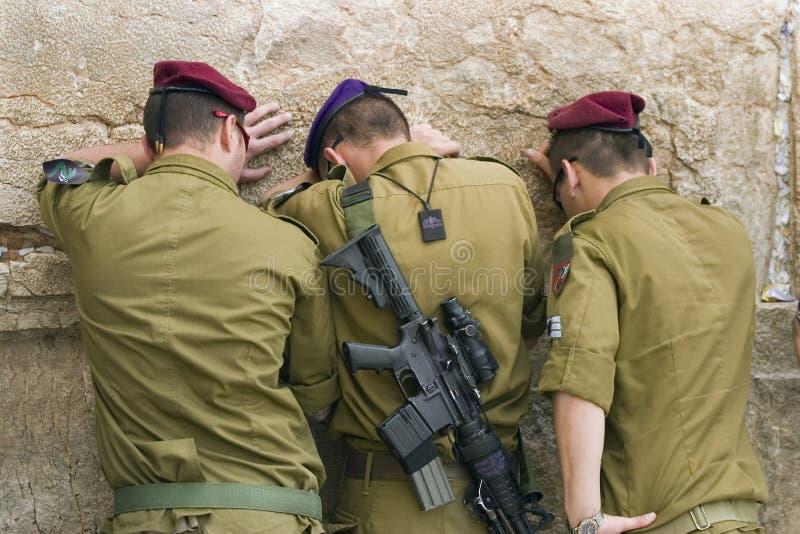 Praying soldiers royalty free stock photos