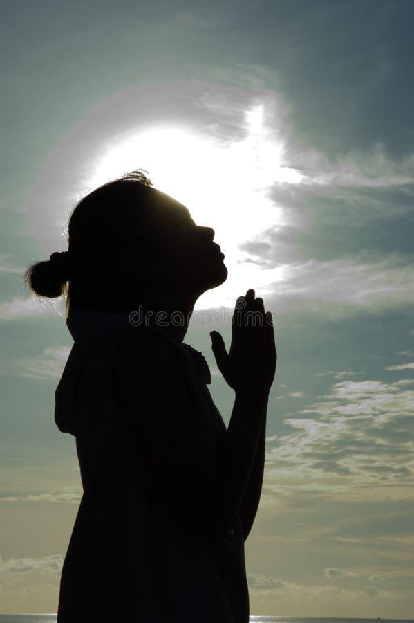 Praying at Sunrise royalty free stock photo