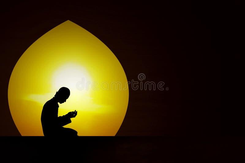 Praying at sunset stock images