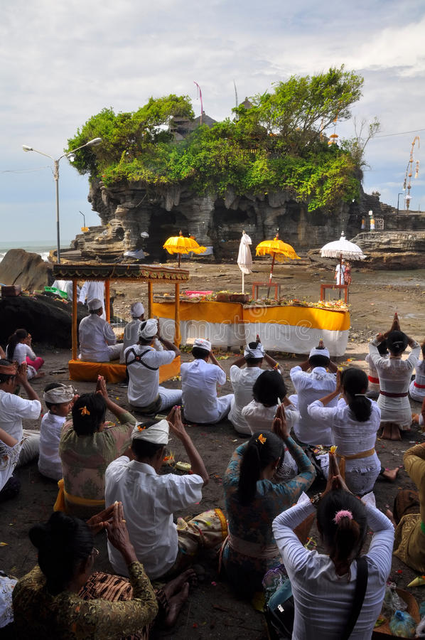 Praying at the Temple of Tanah Lot, Bali Indonesia royalty free stock photography