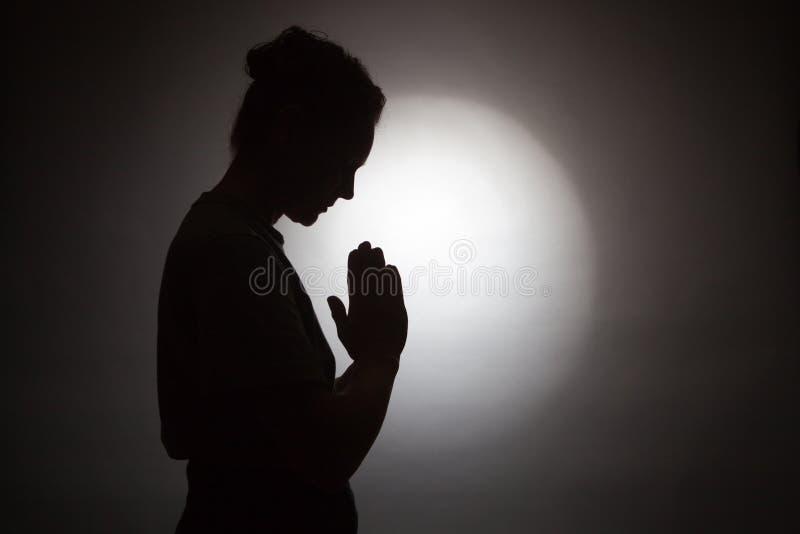 Praying woman stock photos
