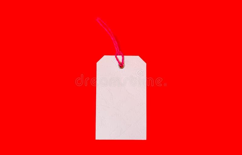 Preço branco no fundo vermelho Preço liso fotos de stock