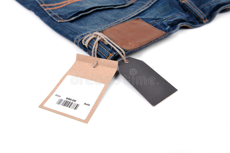 Preço com o código de barras em calças de brim fotos de stock