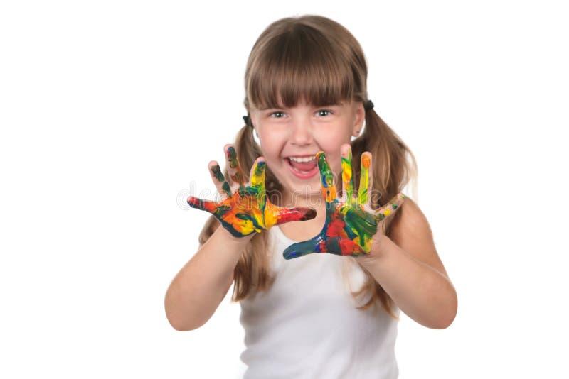 Pre bambino felice del banco con le mani verniciate fotografia stock libera da diritti