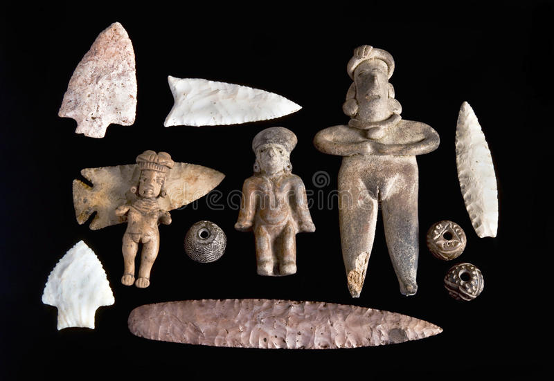 Pre Columbian figures,spindle whorls and arrowheads. Real Pre Columbian figures,spindle whorls and arrowheads royalty free stock photo