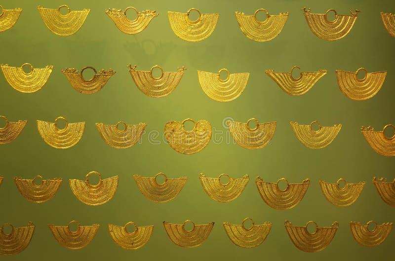Pre Columbian golden jewellery stock image