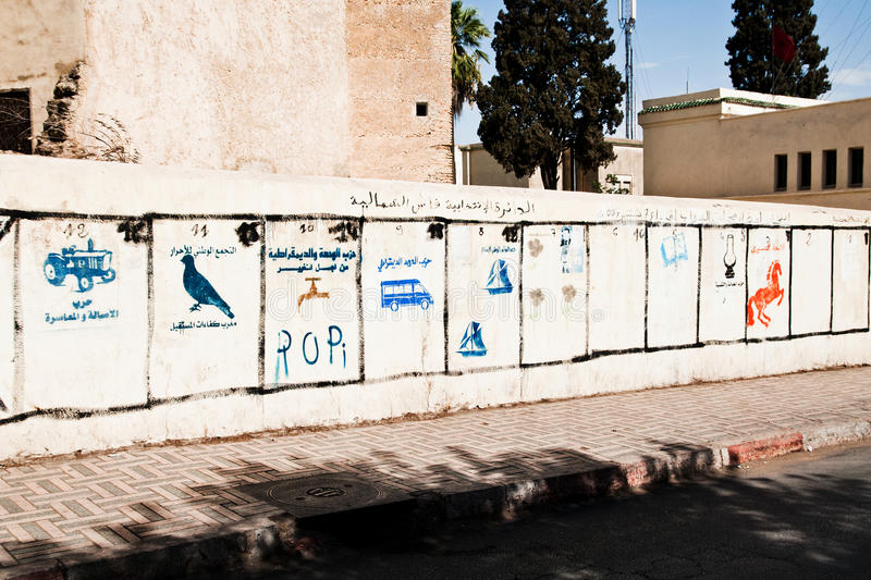 Pre-election campaign parties logos layout on wall, Fes, Morocco stock images