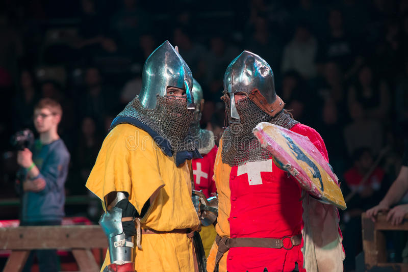 Pre-fight instructions. MOSCOW - DECEMBER 03, 2016: Armored fighters , dressed as knights, fighting at the XI World championship in Medieval combat CUP `DYNAMO stock photography