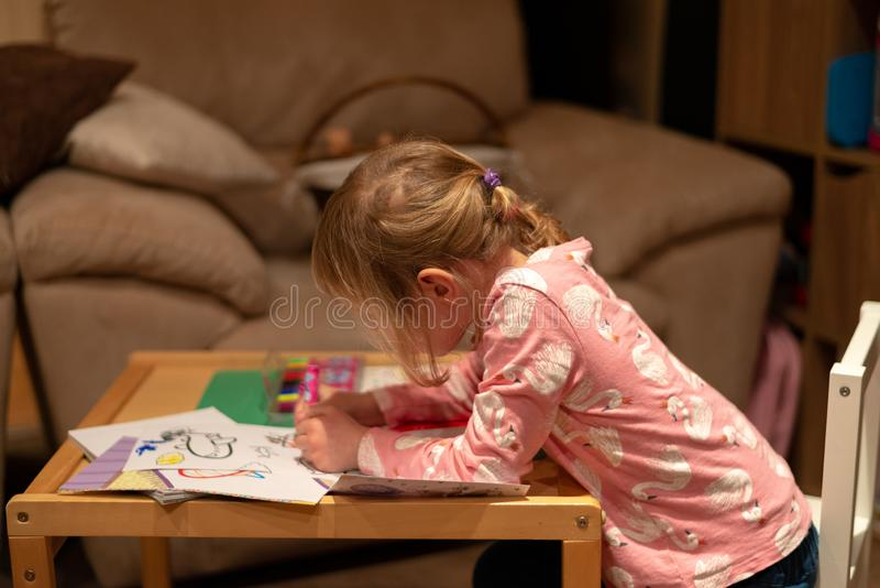 Pre school girl drawing royalty free stock photo