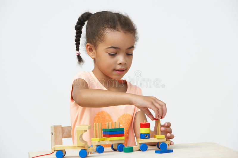 Pre-School Pupil Playing With Wooden Toy Train royalty free stock images