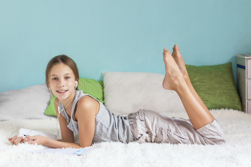 Pre teen girl relaxing at home stock image image 60935555 for Teen home pic
