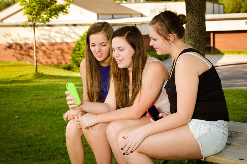 Download Pre-teen Girls Texting While Hanging Out In Front Stock Image - Image: 31046571