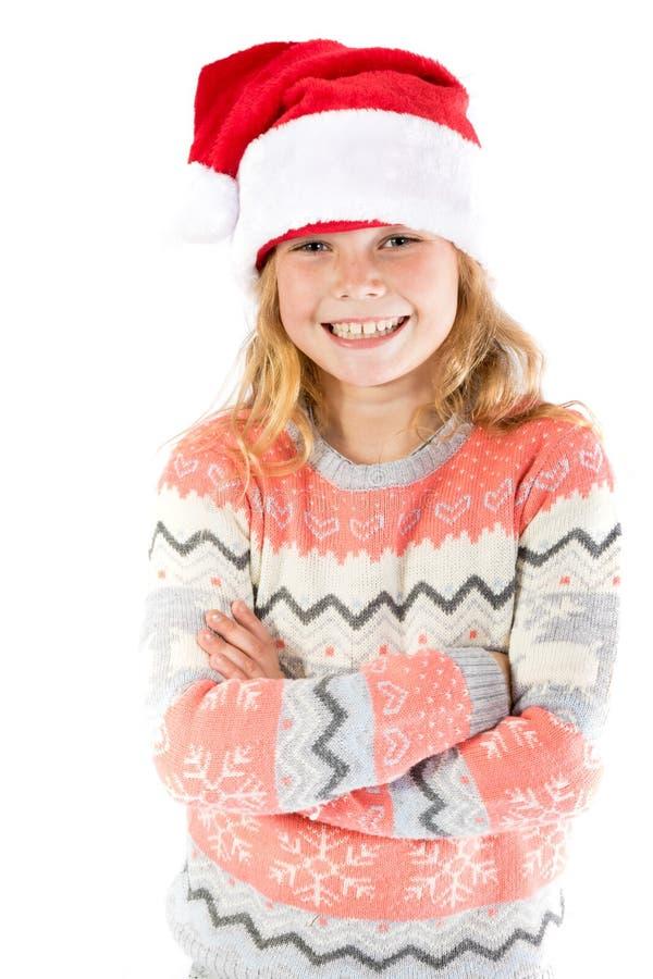 Pre-tonårig flicka som bär en santa hatt arkivfoton
