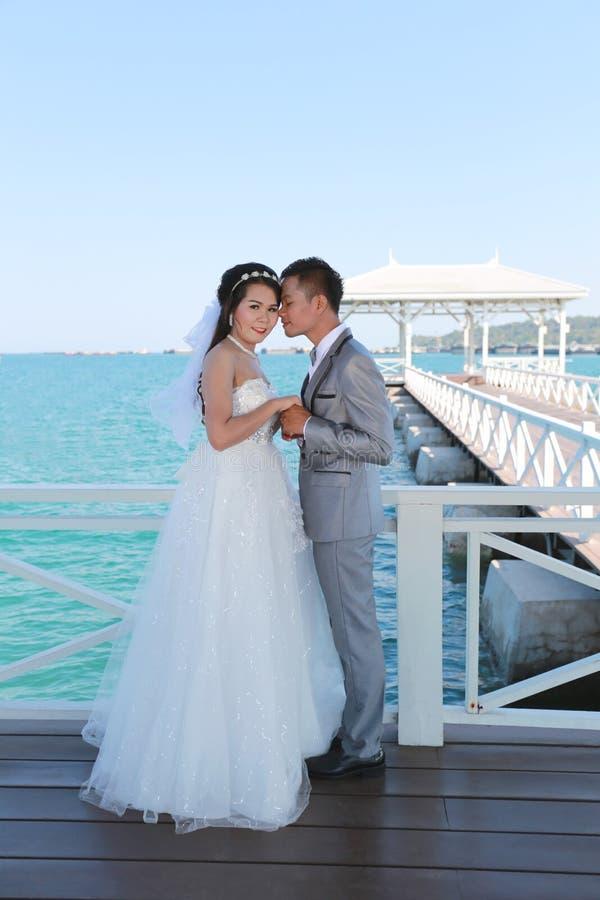 Pre Wedding photography thai couples on a wooden Atsadang bridge. Of Koh Si Chang Island at Thailand in concept love of memory stock photos