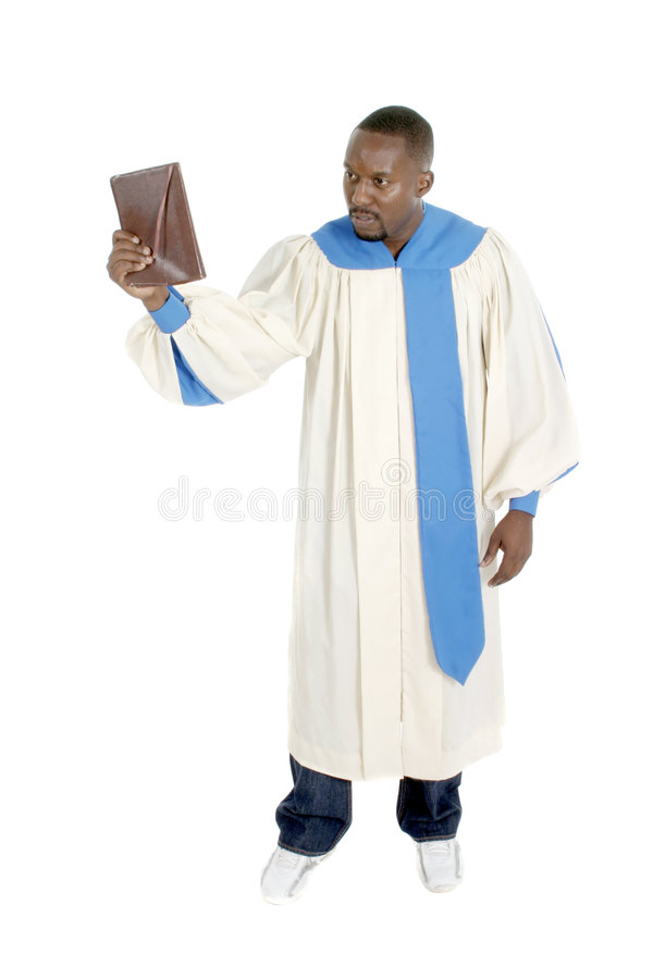 Preacher 2. Man wearing a robe, holding a Bible, and preaching stock photo