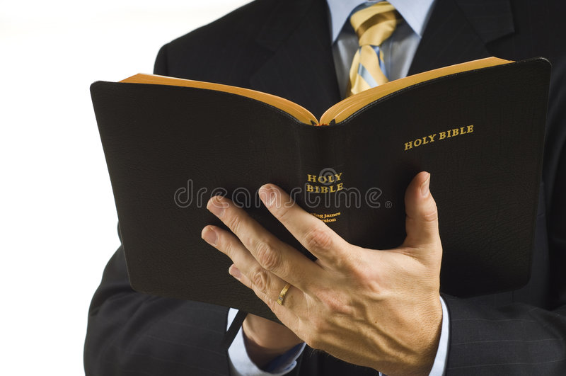 Preacher with Bible stock photography