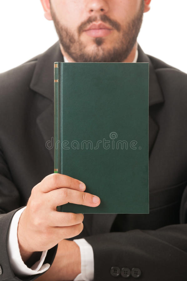 Preacher holding a book of prayers. Elegant preacher holding a book of prayers stock images