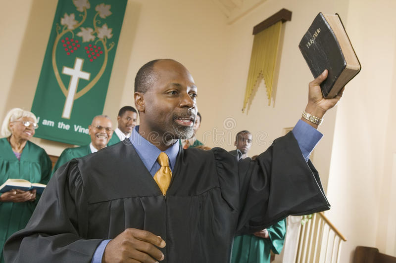 Preacher Preaching the Gospel in church stock photography