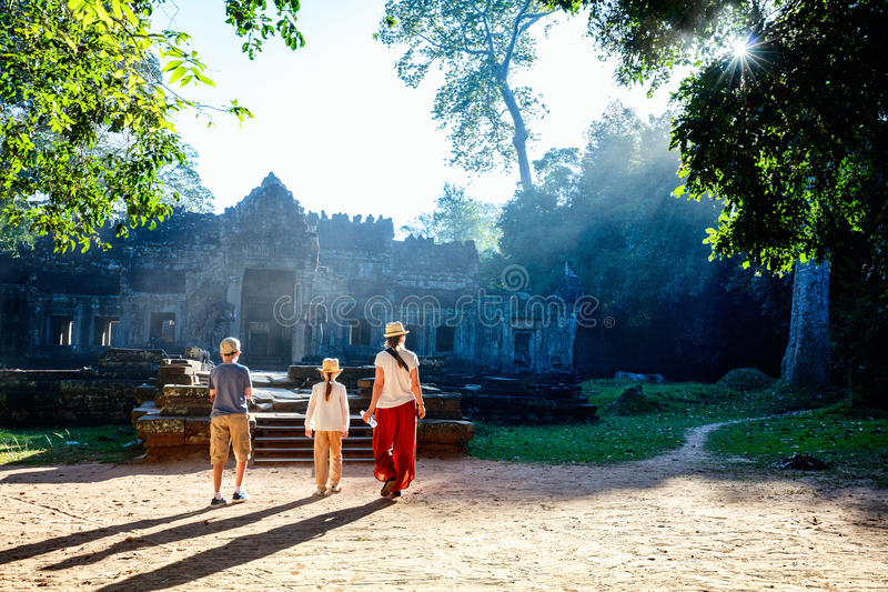 Preah Khan temple. Family visiting ancient Preah Khan temple in Angkor Archaeological area in Cambodia royalty free stock photos