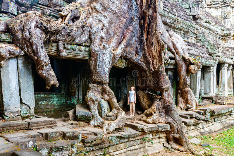 Preah Khan temple. Little girl at ancient Preah Khan temple in Angkor Archaeological area in Cambodia stock photography