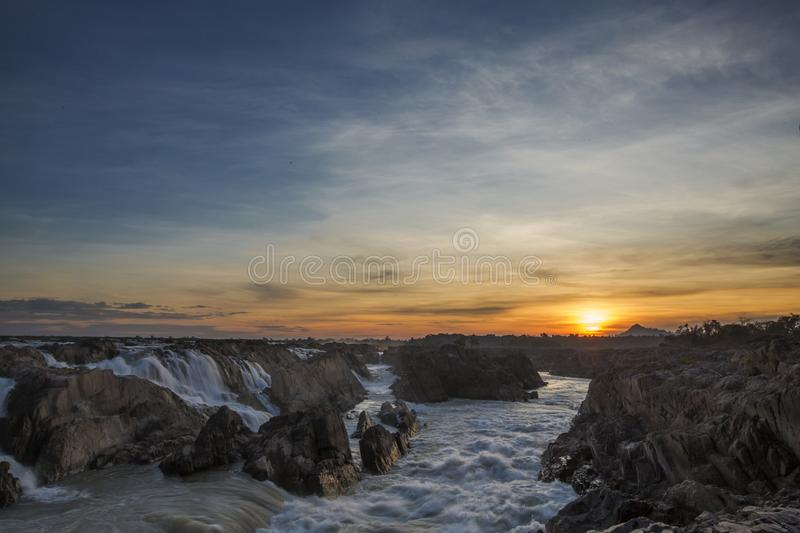 Preah nimth waterfalls in cambodia during sunrise royalty free stock photography