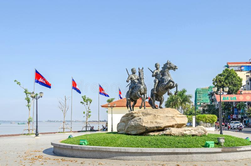 Preah Sisowath Quay with the monument to the warriors Techo Meas. Phnom Penh, Cambodia - April 9, 2018: View of the Preah Sisowath Quay with the horse monument royalty free stock photos
