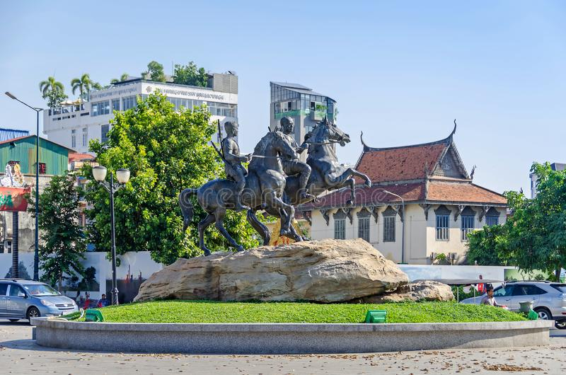 Preah Sisowath Quay with the monument to the warriors Techo Meas and Techo Yot. Phnom Penh, Cambodia - April 9, 2018: View of the Preah Sisowath Quay with the stock image