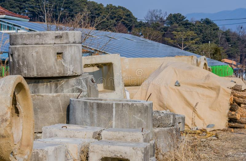 Precast concrete culvert sections. With array of solar panels and trees in background royalty free stock images