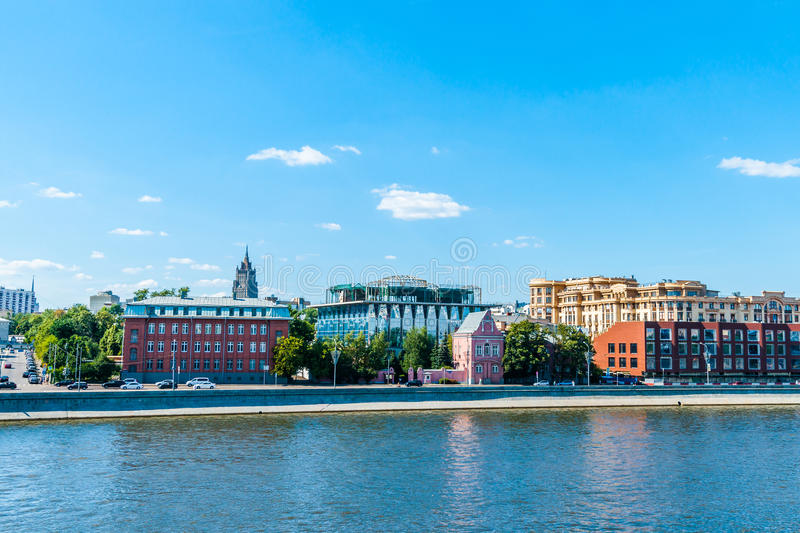 Prechistenskaya embankment of the Moscow river, Mo. Scow, Russia, on Sunday, July 20, 2014. The embankment limits the very expensive and prestigious district in stock photography