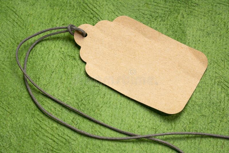 Precio de papel en blanco con una guita fotos de archivo libres de regalías