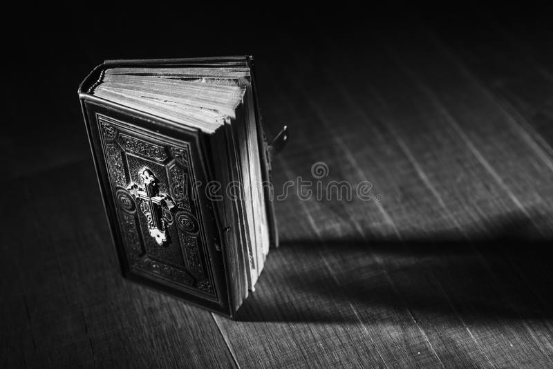Precious antique Bible on a wooden desktop stock photos