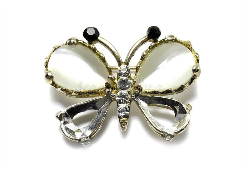 Precious brooch butterfly. On a white background royalty free stock photo