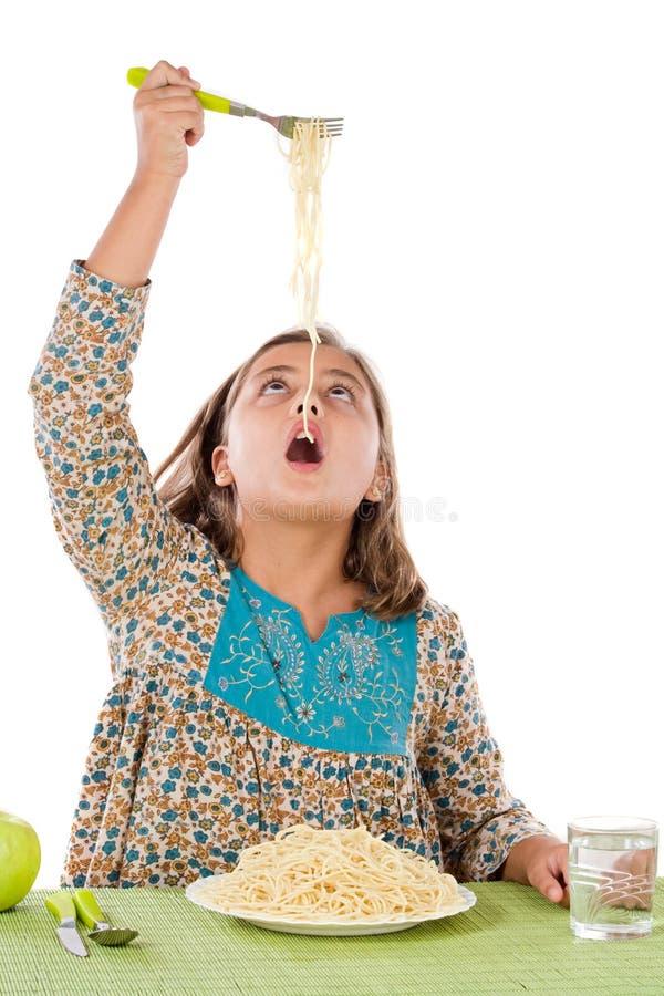 Precious girl eating spaghetti royalty free stock photo