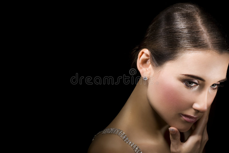Precious jewellery. Portrait of beatiful woman with precious jewellery. Space for text royalty free stock image