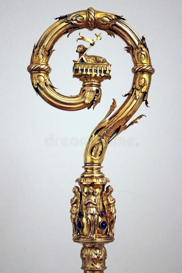 Precious pastoral scepter of bishop or cardinal. Gold and silver jewelery item stock photos