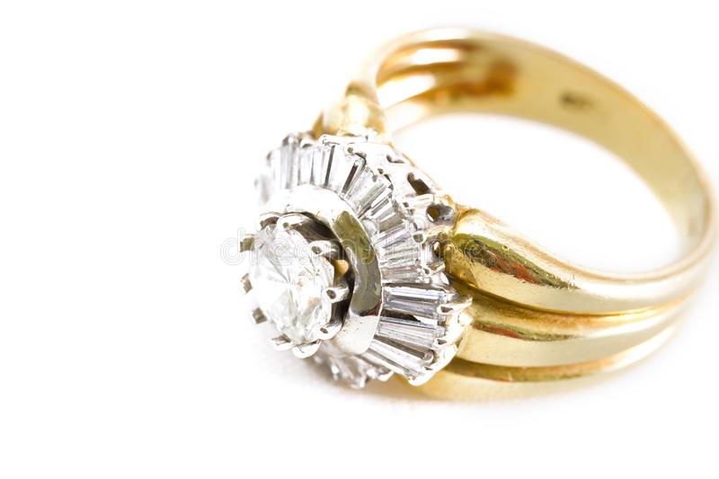 Precious ring with diamonds. Photo of yellow gold ring with white diamonds and one big soliter royalty free stock images