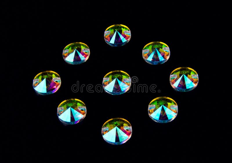 Precious stones crystals in the shape of a circle on a black background. stock photography
