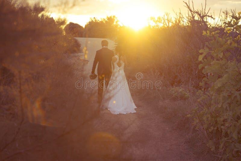 Precis gift, barnpar i The Sun fotografering för bildbyråer