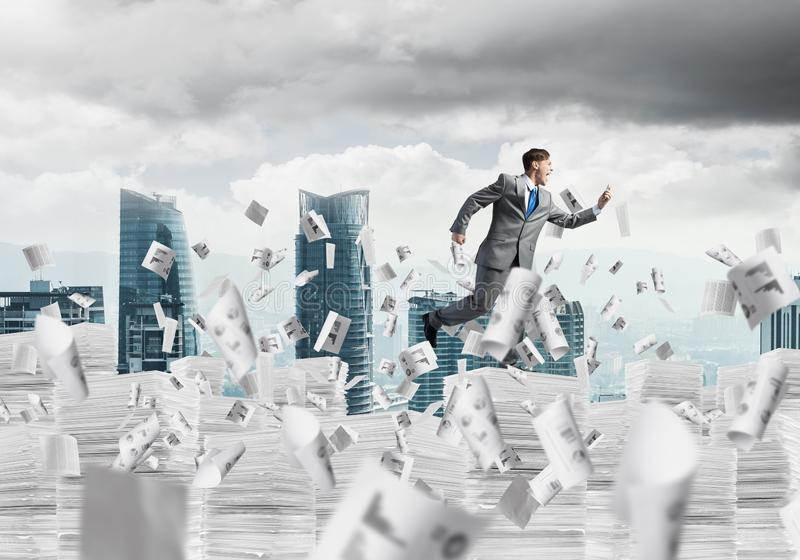 Precise businessman in suit running with phone. stock images