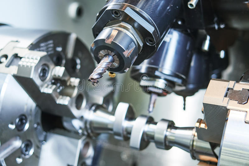 Precision CNC metal machining by mill, drill and cutter stock photography