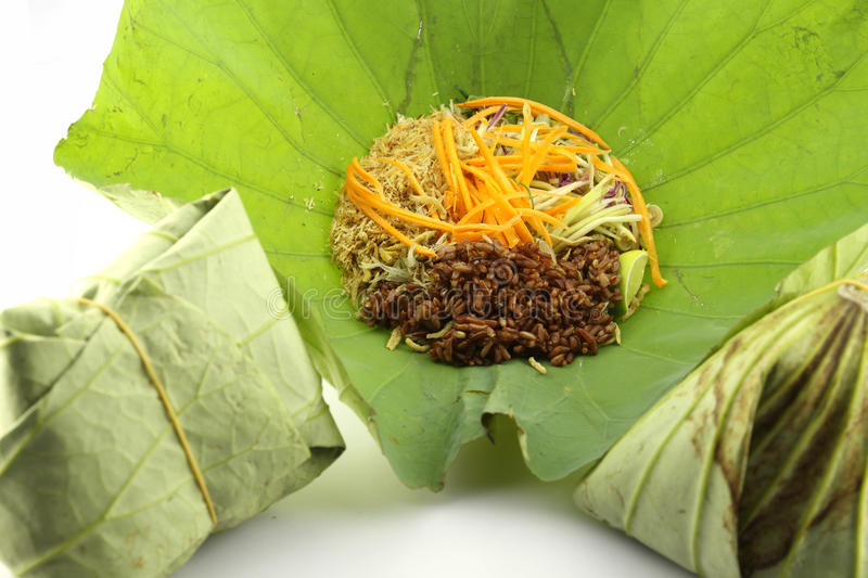 Precision herbal rice wrapped in lotus leaf. stock photography