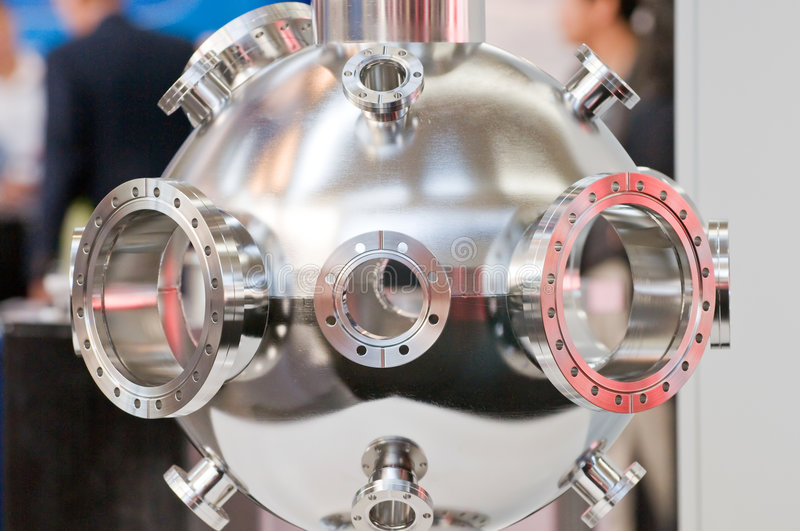 Precision scientific equipment. A view of stainless steel high tech, precision scientific equipment used to research new materials in a vacuum or super cold stock photo