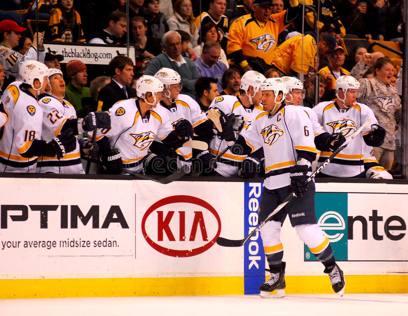 Predators score!! (NHL Hockey). Nashville Predators captain Shea Weber is congratulated by his teammates after scoring a powerplay goal royalty free stock image