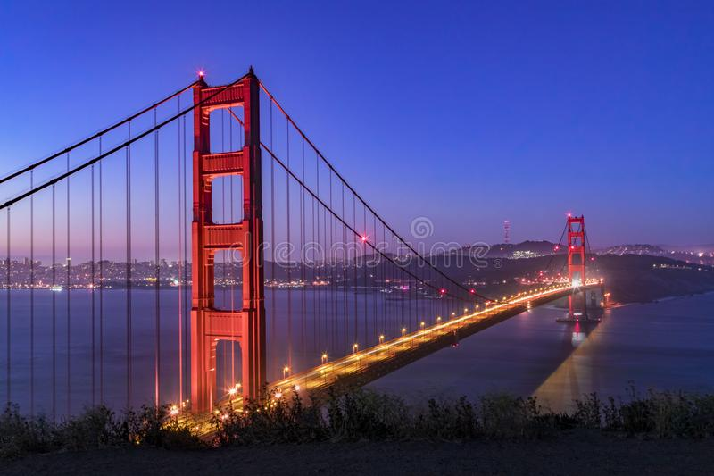 Predawn Golden Gate from Battery Spencer overlooking San Francosco Bay. The Golden Gate, suspension bridge spanning the strait of the same name, is seen just royalty free stock photo