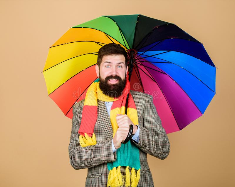 Predict future weather trends. Man bearded guy hold colorful umbrella. It seems to be raining. Rainy days can be tough. To get through. Prepared for rainy day stock photography