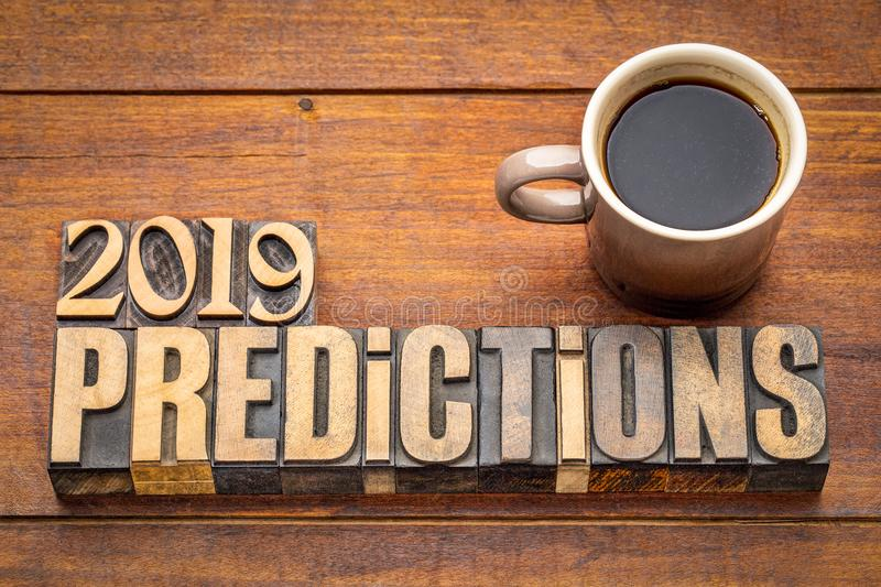2019 prediction concept. Text in vintage letterpress wood type printing blocks with a cup of coffee royalty free stock image