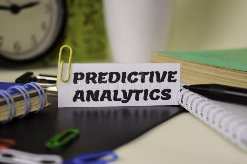 Predictive Analytics on the paper isolated on it desk. Business and inspiration concept stock images